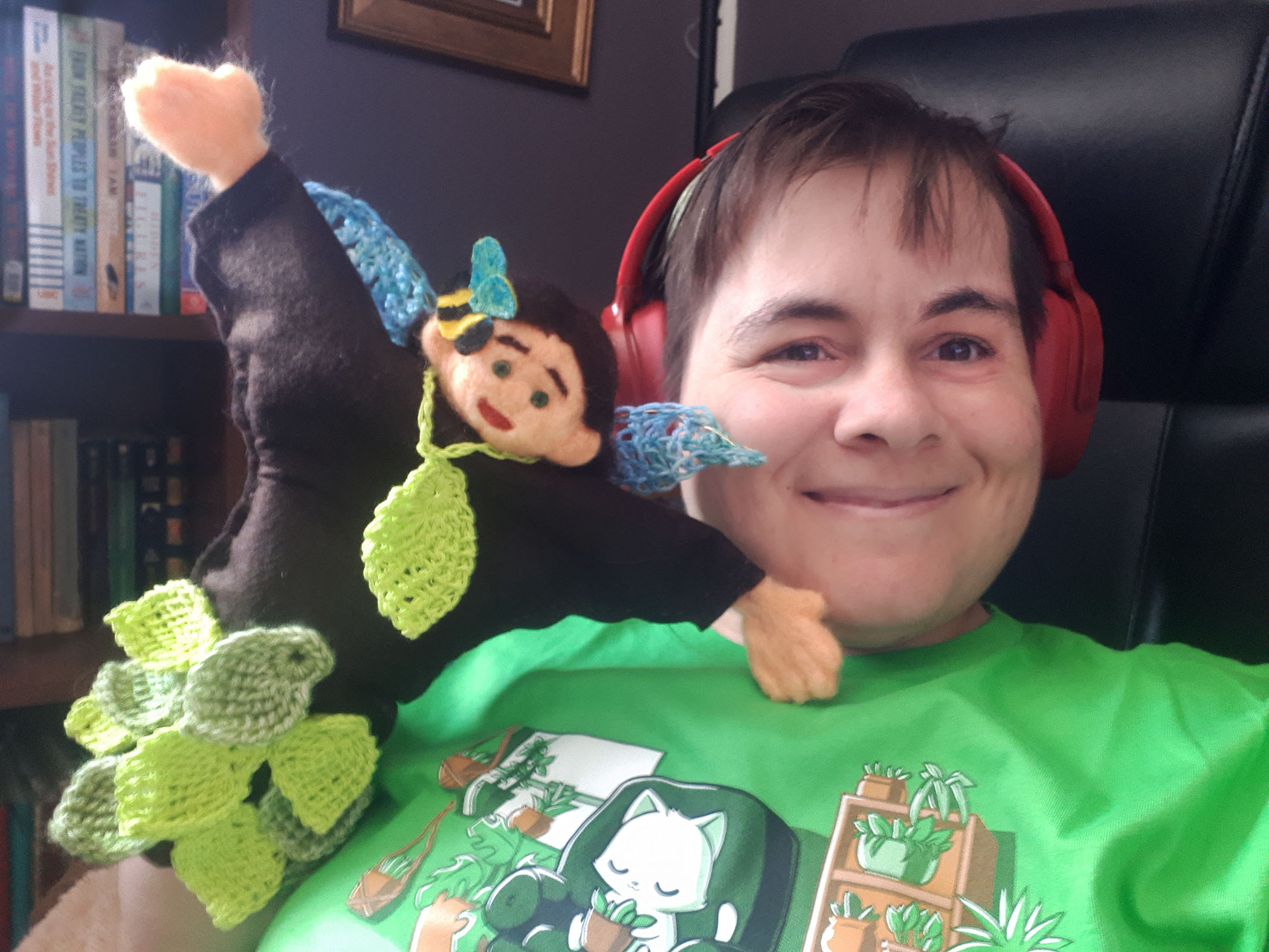 Shows Religious Director Ilara with one of the Children's Weekly Story Corner Puppets, a fairy named Elm with a green leaf skirt and a bee on her head.