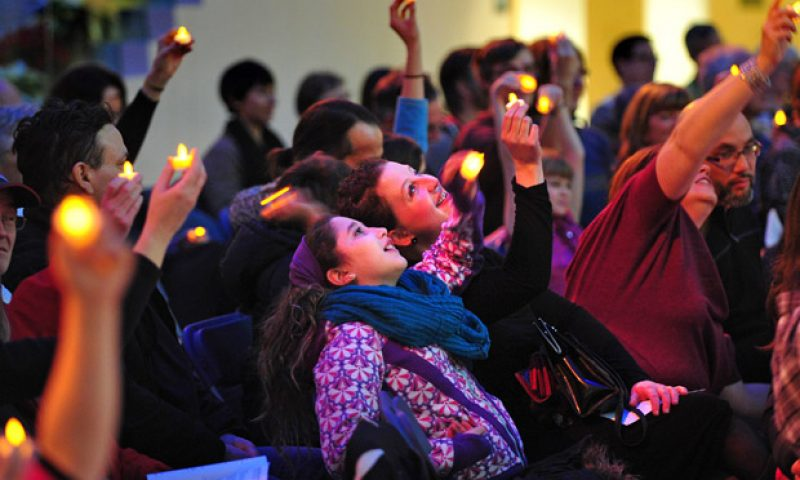 EDMONTON, ALTA: December 20, 2013 -- Fiona Cavanagh and her daughter Lucia, 10, looking skyward during the restoring the light - candle meditation - at the 26th annual Winter Solstice Celebration put on by the Westwood Unitarian Congregation at city hall in Edmonton, December 20, 2013. The winter solstice is upon us with December 21st being the shortest day of the year. (ED KAISER-EDMONTON JOURNAL)